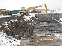 December 2013 - Contractor cleans excavation floor with longstick excavator
