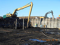 December 2013 - Workers clean the sheet pile