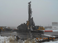 February 2014 - Equipment installs barrier wall on Kellogg Street properties