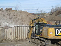 January 2016 - Removing portion of former trash pit walls