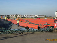July 2016 - Placing geocomposite drainage layer panel