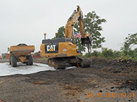 June 2015 - Loading end dump on plastic at former Jersey City property