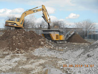 March 2014 - Contractor crushes concrete debris