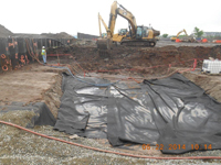 May 2014 - Geotextile is placed in preparation for backfilling