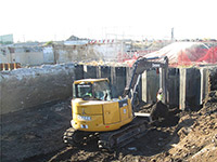 October 2015 - Excavating near sheeting with small back hoe