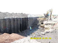 September 2015 - Cleaning barrier wall prior to backfill